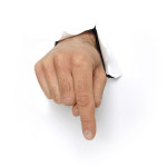 Hand bursting through white card pointing down